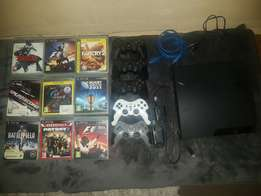 Ps 3, hdmi cable, remote charger, 5 remotes, 9 games R2800