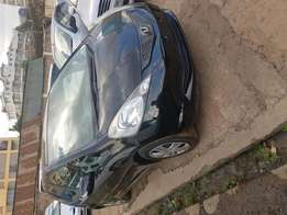 Honda fit 2010 in black colour with glass roof