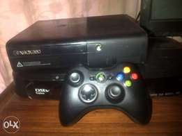 XBox 360 with 2 remotes and games
