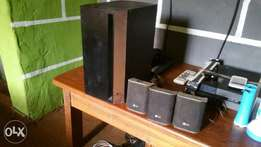 Clean Home theater woofer nd speakers