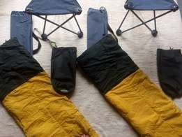 2 camping chairs and 2 sleeping bags