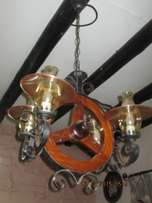 Wagon wheel overhead light fitting.