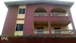 2 storey building with multiple flats.