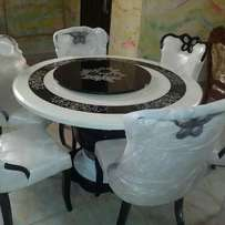 Round marble dining table with 6 chairs