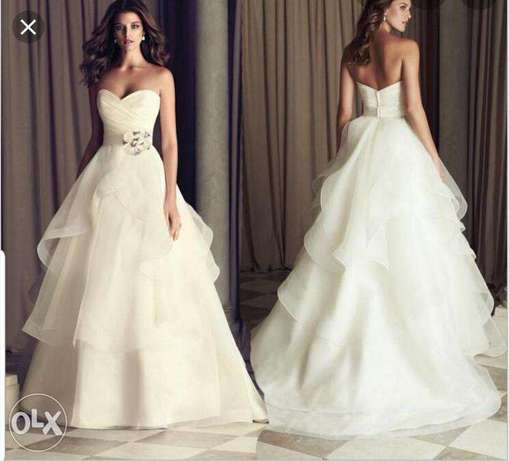 A stunning wedding gown perfectly designed by designer Paloma Blanca