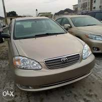 2094 used gold corolla from me