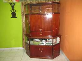 A Corner Wall Unit. Made of Hard Wood and in Excellent Condition.