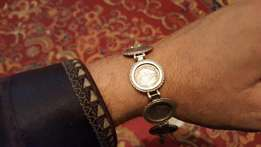 Vintage antique silver bracelet with tiekie coins,beautiful and good