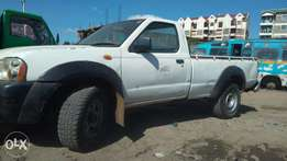 A 4×4 Nissan hard body p/up in good working condition