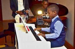 Piano guitar Violin saxophone Trumpet voice sessons at Baylec Academy