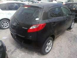 Mazda demio KCN number 2010 model loaded with alloy rims, good mu