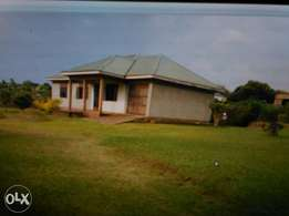 3 bedroom house and garage on 30 decimals of mailo land bweya at 160m