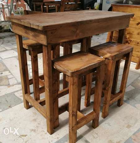 High kitchen table and four chairs