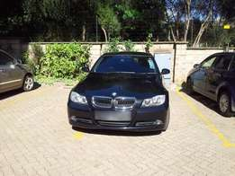 320i, 2005, Black BMW. Clean, well maintained.