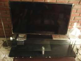 TV stand with beautiful black and grey coach