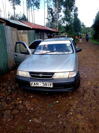 L am selling a clean crey Nissan sunny b14 ,buy and drive Kericho Town - image 4
