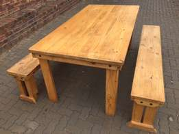Table with two benches. Solid wood. Table is 2m long, 1m wide and 0,84