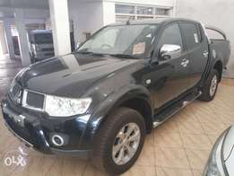 Black Mitsubishi L200 pickup. Hire purchase