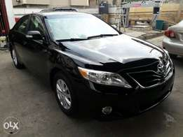 Tincan Cleared 2011 Toyota Camry LE black.
