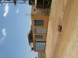 Business house on sale at tari mbili 20 metres from uganda road in eld