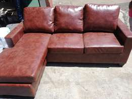 Brand new leather l shape couch with daybed -last one left at cost