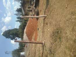 1/4 an acre plot on sale at signpost estate 300 metres from uganda Rd.