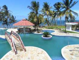 Executive 3 bedroom BEACH FRONT apartment with swimming pool