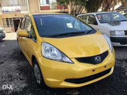 Extremely clean yellow Honda fit 2010 model