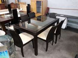 Glass top dining room table and chairs for sale !!!