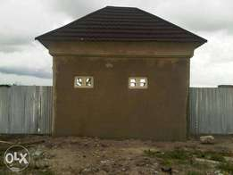 One acres of land with propose buildings, c of o 4 sale at eleko beach
