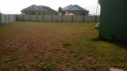 A Walled And Gated plot of land For Sale At Community 22.Tema