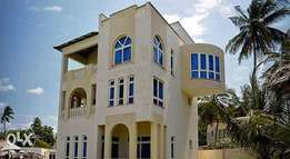 Modern Executive Beach frontage 1,2,3 bedroom fully furnished Home