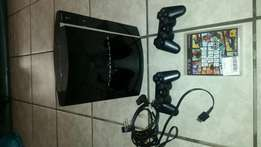 PS3 console complete with two controllers, two games.
