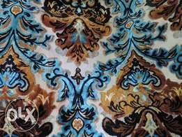 Flowery patterned thick cotton fabrics available, tailoring too. Kenya