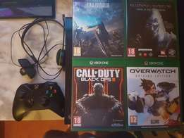 Xbox one + 4 games and remote