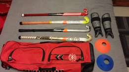 4 field hockey sticks,1hockeybag,1pair of shinpads,4cones,4hockeyballs