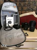 Canon EOS 1100D with Lowepro Camera backpack and two lenses
