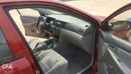 Just arrived tokunbo toyota corolla 2003 model wine color up for grabs