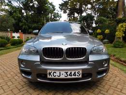 A locally used well maintained BMW X5 grey in colour
