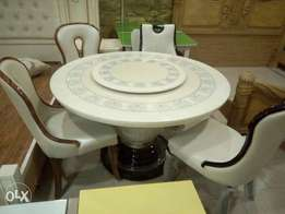Round Marble top dinning table with 6 skin solid chairs