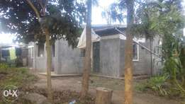 Plot with house for sale
