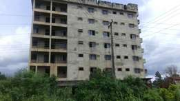 Giant Hotel building +20 plots of Land for sale