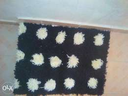 Brand new fluffy door mats and carpets.