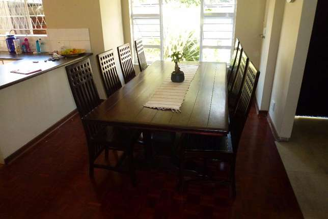 10 seater solid wood dining room table and chairs Parkmore - image 1