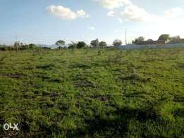 A plot with tittle touching tarmac along kangundo road,tittle for sale
