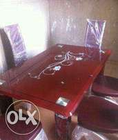 Brown 6 sitter glass dining table
