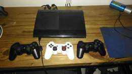 PlayStation 3 slim with 23 games 3 remotes and a ear piers