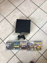 Sony PlayStation 3 slim with 5 games and 2 controllers