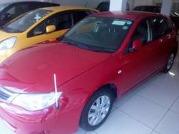 Metallic Red Subaru Impreza Fully loaded 2009
