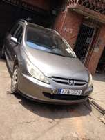 clean first body tokunbo Peugeot 307 04 with full option